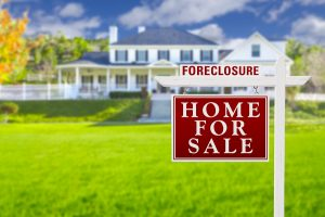 Foreclosure Home For Sale Real Estate Sign in Front of Beautiful